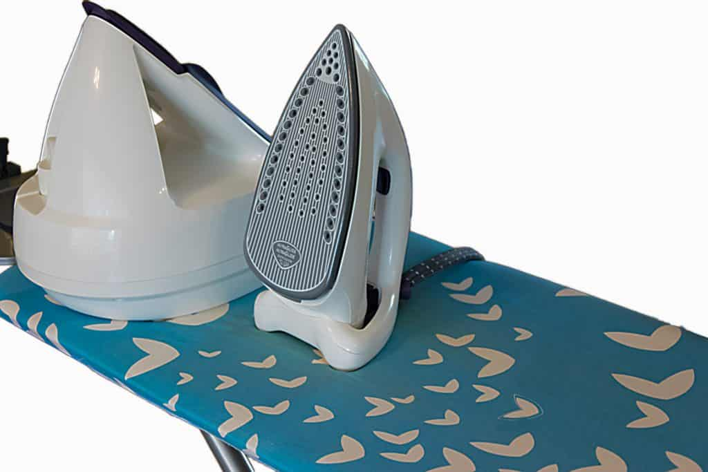 Steam iron resting on an ironing board