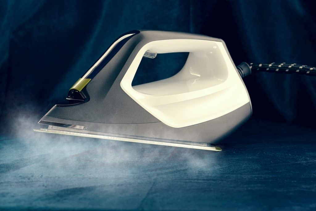 Steam coming out underneath a steam iron